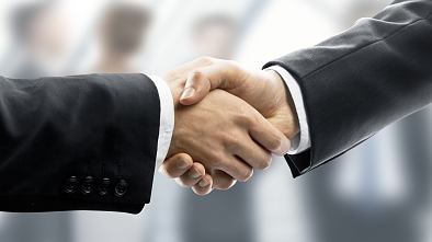 business handshake on people in office background